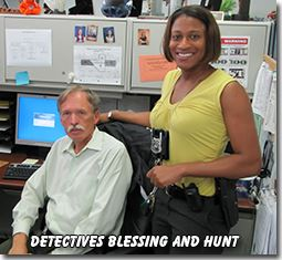 Detectives Blessing and Hunt at a Computer