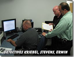 Detectives Kriebel, Stevens, and Erwin at a Computer