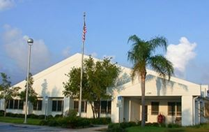 pinellas park fire department building with palm tree and flag in front