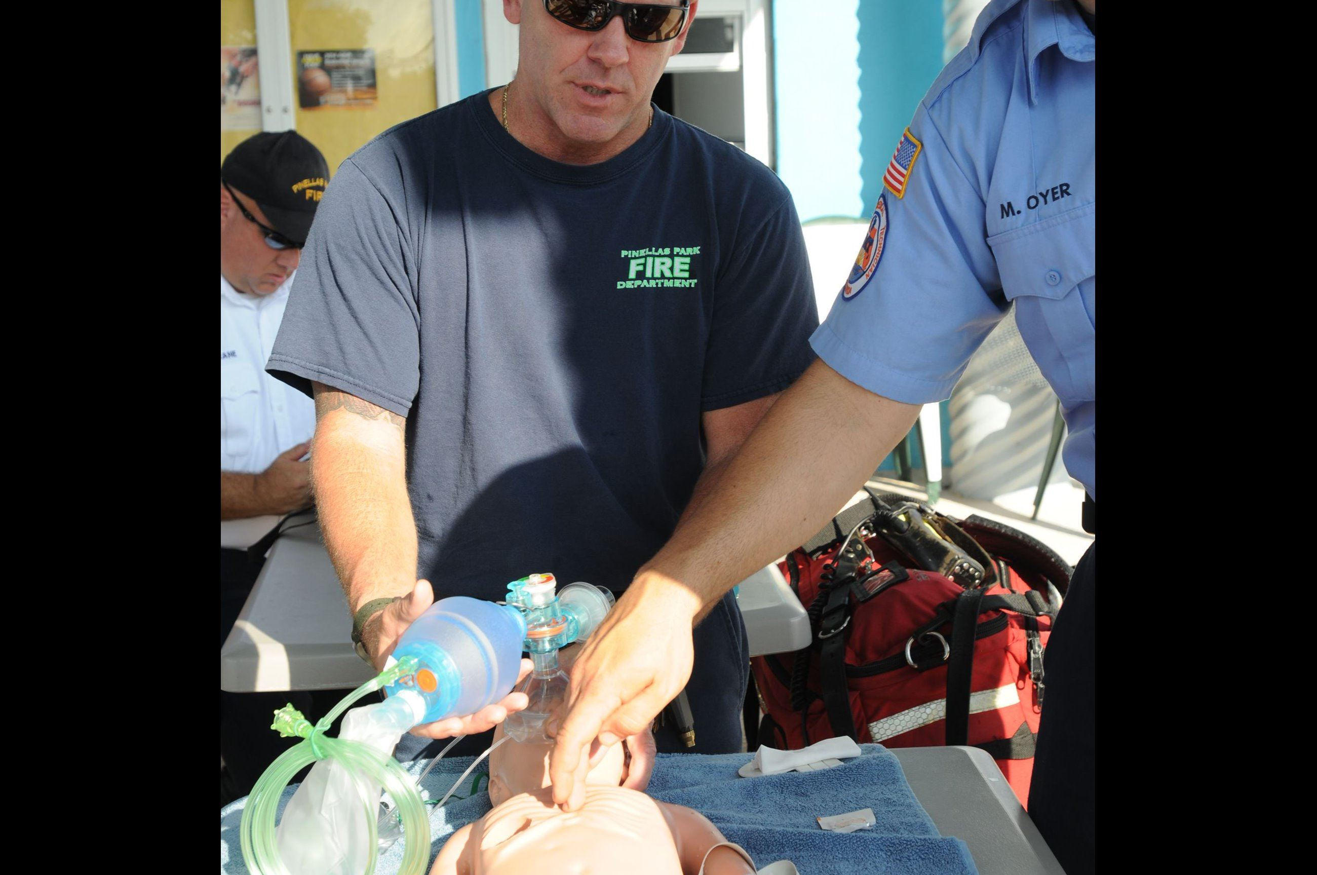 EMS trainees practicing CPR on child dummy