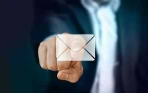 Man pointing to a mail envelope