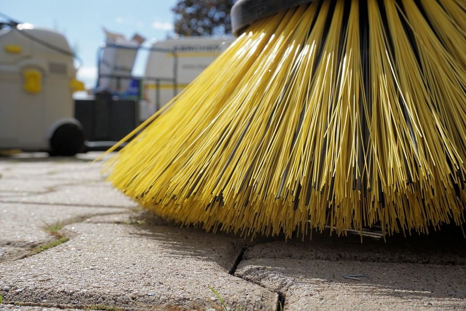 Yellow Broom Bristles Sweeping Concrete