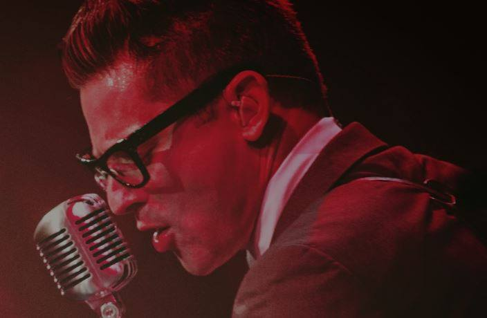 Buddy Holly Tribute Artist Close up singing in microphone