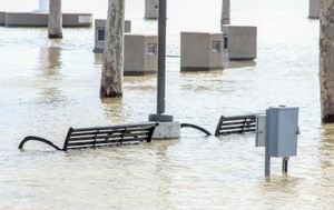 Flooding coastal waters over 2 park concrete benches