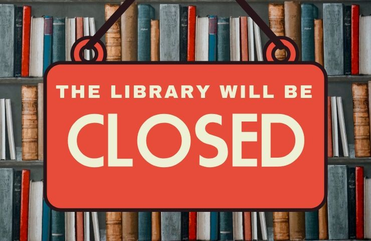 Sign in front of bookshelf that reads The library will be closed