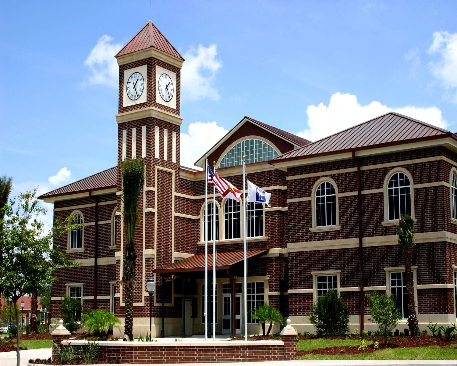 Park Station exterior with clock tower and flag poles