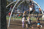 Kids playing on jungle gym at Broderick Park